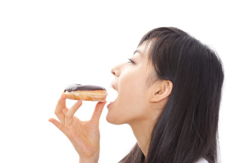 Japanese woman holding a donut