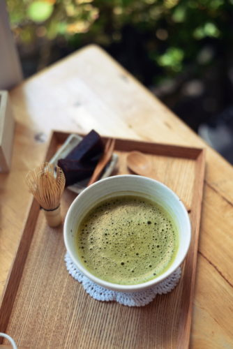 Organic Japanese hot green tea and Japanese wire whisk made of bamboo