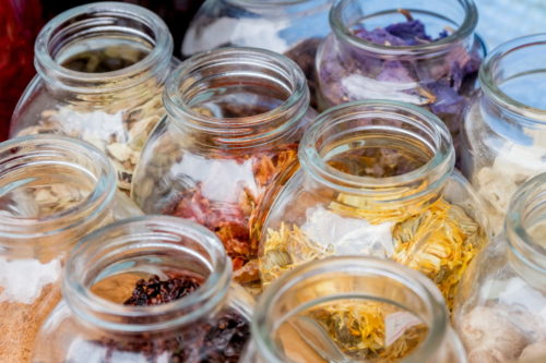 dried spices and tea in glass jars