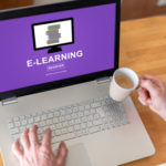 Man using a laptop with e-learning concept on the screen