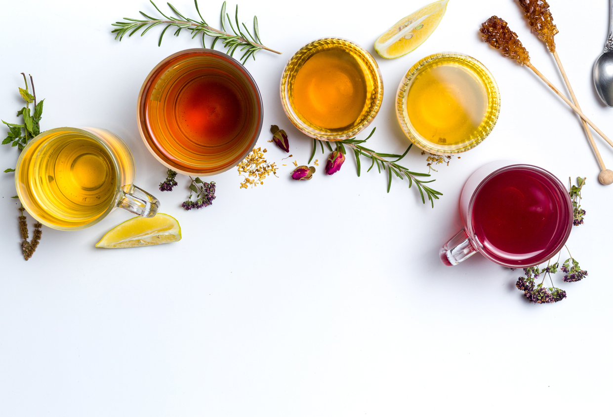 Herbal tea collection prepared in glasses on white background