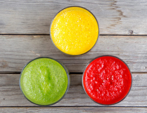 Fresh smoothies in the glass - green, red and yellow paprika
